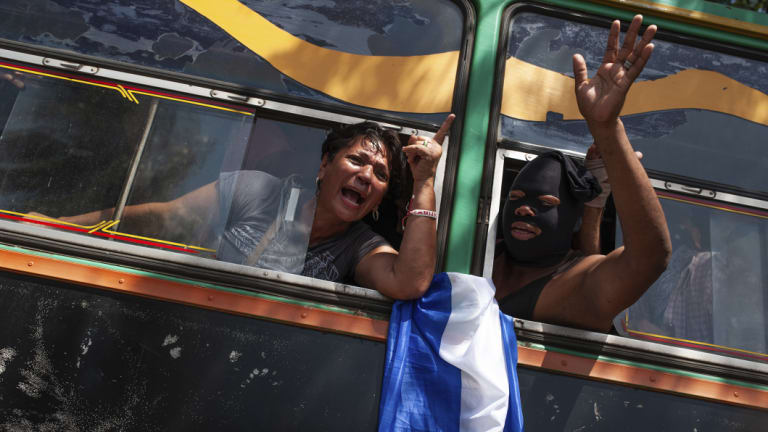 Students who had taken refuge at the Jesus of Divine Mercy church amid a barrage of armed attacks, arrive on a bus to the Metropolitan cathedral, in Managua, on Saturday.