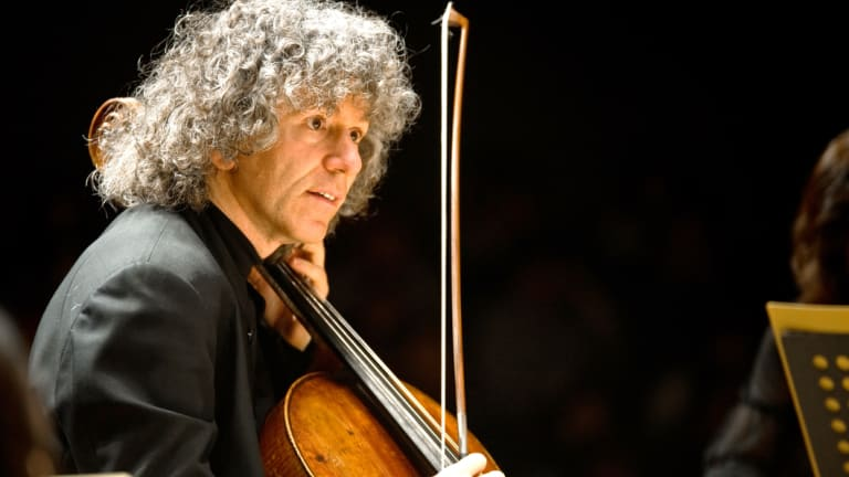 Steven Isserlis played 'Cello Concerto No. 1', 'like a man in a world tipped up on end by madness'.