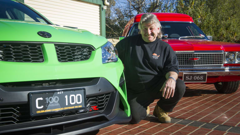 Stefan Jeremenko has the first Centenary of Canberra number plates and a personalised set.