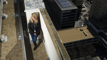 Cheryl O'Donnell on top of Lovett Tower where they are hosting the PCYC plunge where you can abseil or zipline down Lovett Tower.