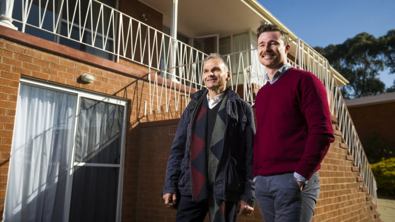 Architects James Gaughwin and Allan Spira discussing plans to transform a Farrer home. They are searching for people who want to convert their McMansions into two or three apartments under the same roof.