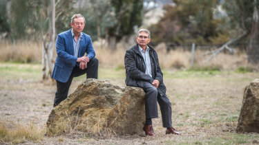 Former Flynn neighbours Robin Eckermann and Peter Toscan are concerned about the impact of a former sheep dip site near their former homes in Fraser. The men, who have both had cancer, are pictured at the end of their street.