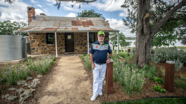 Allan Hawke, former secretary of defence and descendent of the Blundells, in front of the historic Canberra cottage.