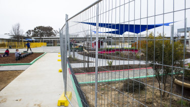 Temporary fencing around garden beds at Harrison School on Thursday. It is unclear whether this is one of the areas that contains non-friable asbestos.