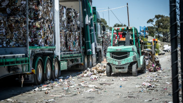 A truck at the Hume recycling facility is loaded with bales of compressed recyclables. Tonnes of recyclable material was dumped into landfill to make additional space.