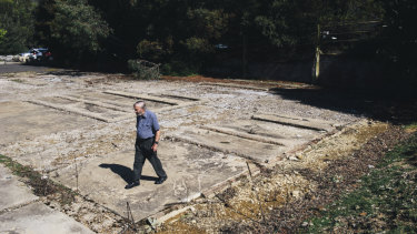 Hamish Lindsay walks over the remains of the Honeysuckle Creek Tracking Station, where he worked.