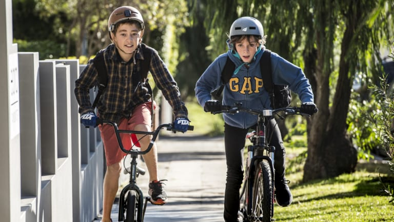 Zack Saad, 13, and his 12-year-old friend Finn Wilkie can now ride together on the footpath