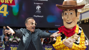 """Tom Hanks hams it up with the """"real-life"""" Woody at the premiere of Toy Story 4."""