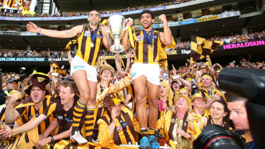 The Hawks celebrate winning on the hottest grand final day ever.