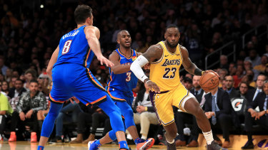 LeBron James and the Lakers won for the 12th time in 14 games to retain the NBA's best record.