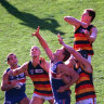 From the Archives, 1997: Dogs stumble as Crows soar into the decider