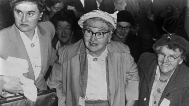 Mrs Melville, centre, arrives at the conference at the Trades Hall in Sussex Street, Sydney on 21 April, 1956.