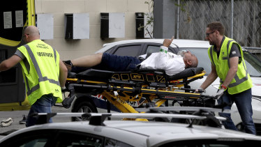 Ambulance staff take an injured man from a mosque in central Christchurch, New Zealand, after the mosque terror attacks on March 15.