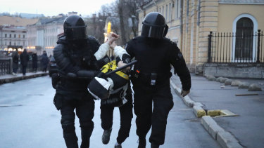 Police detain a man during a protest in St Petersburg, Russia.