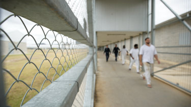 Staff escorting prisoners through Lotus Glen Correctional Centre.