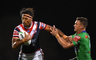Sitili Tupouniua tries to break a Jack Wighton tackle.