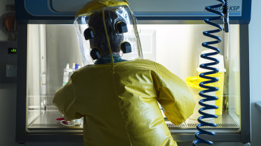 A virologist works inside the Spiez Laboratory that conducts chemical weapons tests in Switzerland.
