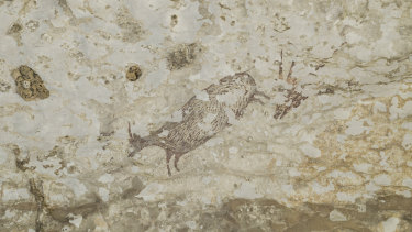 The cave art depicts half-human figures in hunting scenes and has been dated to at least 44,000 years ago.