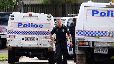 Police at a crime scene just north of Brisbane in April after a man was shot dead at a unit block.