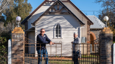 Peter Sanders (left) and his husband Peter Grace in front of St Mary's Anglican Church, Armidale, where Peter Sanders was paid as an organist and his husband Peter had a volunteer leadership role.