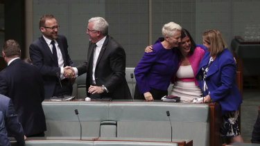 Crossbench MPs Adam Bandt, Andrew Wilkie, Kerryn Phelps, Julia Banks and Rebekha Sharkie celebrate after the medivac bill passes the House of Representatives on Tuesday, February 12, 2019.