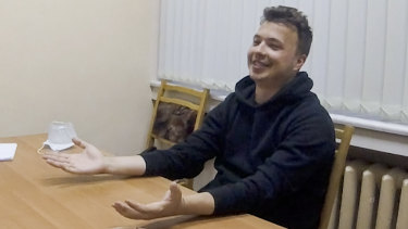Dissident blogger Raman Pratasevich smiles in a video confession which opposition figures say is coerced.