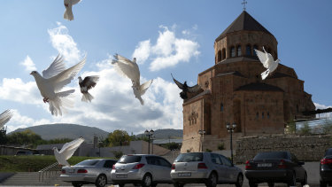 Pigeons fly near Holy Mother of God Cathedral in Stepanakert during a military conflict in the separatist region of Nagorno-Karabakh.