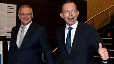 Prime Minister Scott Morrison and former prime minister Tony Abbott arrive at the tribute dinner Thursday night.