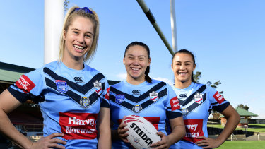 Under-18s Blues player Maddison Weatherall, centre, with senior stars Kezie Apps and Corban McGregor at North Sydney Oval before the women's Origin clash.