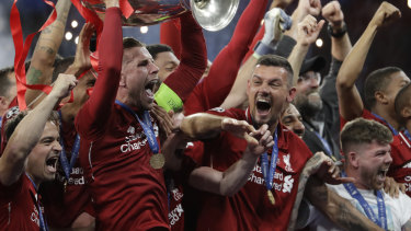 Six times: Liverpool captain Jordan Henderson with the Champions League trophy.