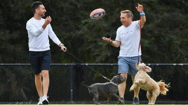 Jason Sellyn, pictured right, with friend Adam Lang and their dogs Archie and Ringo, is experiencing a deepening of his friendships during COVID-19.