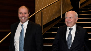 Treasurer Josh Frydenberg and former prime minister John Howard arrive at the Miramare Gardens dinner on Thursday.