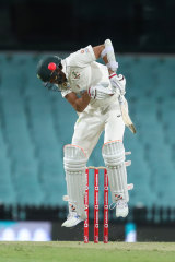 Harry Conway is struck by a short ball at the SCG on Friday night.