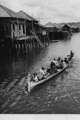 A village scene on the river Kampong, May 1, 1950.
