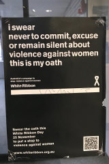 A sign outside of Ballarat Police station, featuring an oath not to commit, excuse or remain silent about violence against women.
