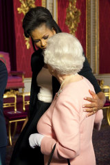 Michelle Obama, wife of US President Barack Obama, left, walks with the Queen.