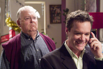 Mobile phones became a new fixture on Neighbours, yet some faces have barely changed, like Harold Bishop (Ian Smith) and Paul Robinson (Stefan Dennis) seen here in a 2005 episode.