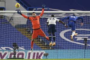 Spurs goalkeeper Hugo Lloris jumps for the ball against Chelsea along with teammate Serge Aurier (centre) and Christian Pulisic of the Blues.