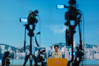 'Not doom and gloom': Hong Kong Chief Executive Carrie Lam holds a press conference in Hong Kong on Tuesday.