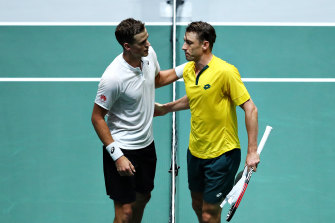 Canadian Vasek Pospisil, left, acknowledges a disappointed John Millman after their match.