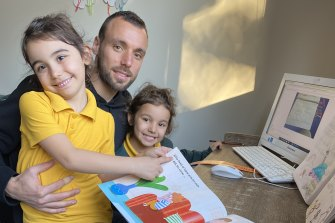 Melbourne City's Florin Berenguer with his daughters Chlea and Leana.