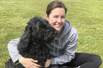 Tegan Stait with Ruby, one of the pampered pooches she house sits.