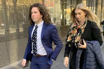 Callum Buczak and girlfriend Alexandra McDonough leave Melbourne Magistrates Court on Friday.