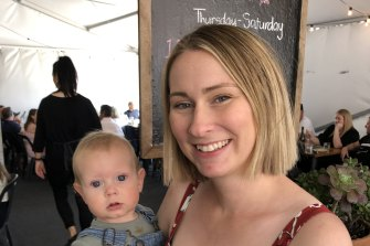 Midwife Marnie Icim, 29, (pictured with son Alexander) has contemplated leaving the profession.