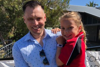 Martin from Melbourne is reunited with his daughter Leni, 6, in Newcastle after he received a travel permit to enter NSW.