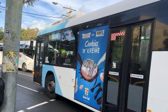 A junk food ad on the side of a bus in Randwick.