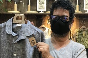 Warapote Masamandana displays  items at his stall in the Chatuchak Weekend Market in Bangkok.
