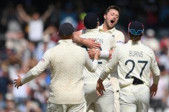 Ollie Robinson celebrates after taking the wicket of Virat Kohli.
