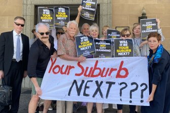 Kangaroo Point residents - including spokesman Dr Ian Scott (left) outside City Hall - are questioning the influence of developers on Brisbane City Council's neighbourhood planning process.