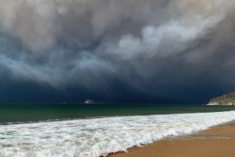 "The view of the fire-generated storm over the Malua-Batemans Bay area as seen from about 20 kilometres away. ""It was god awful,"" Mr Constance said of his experience."